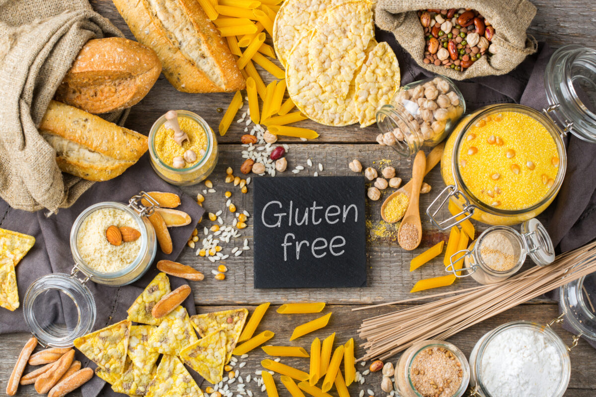 Healthy eating, dieting, balanced food concept. Assortment of gluten free food and flour, almond, corn, rice on a wooden table. Top view flat lay background